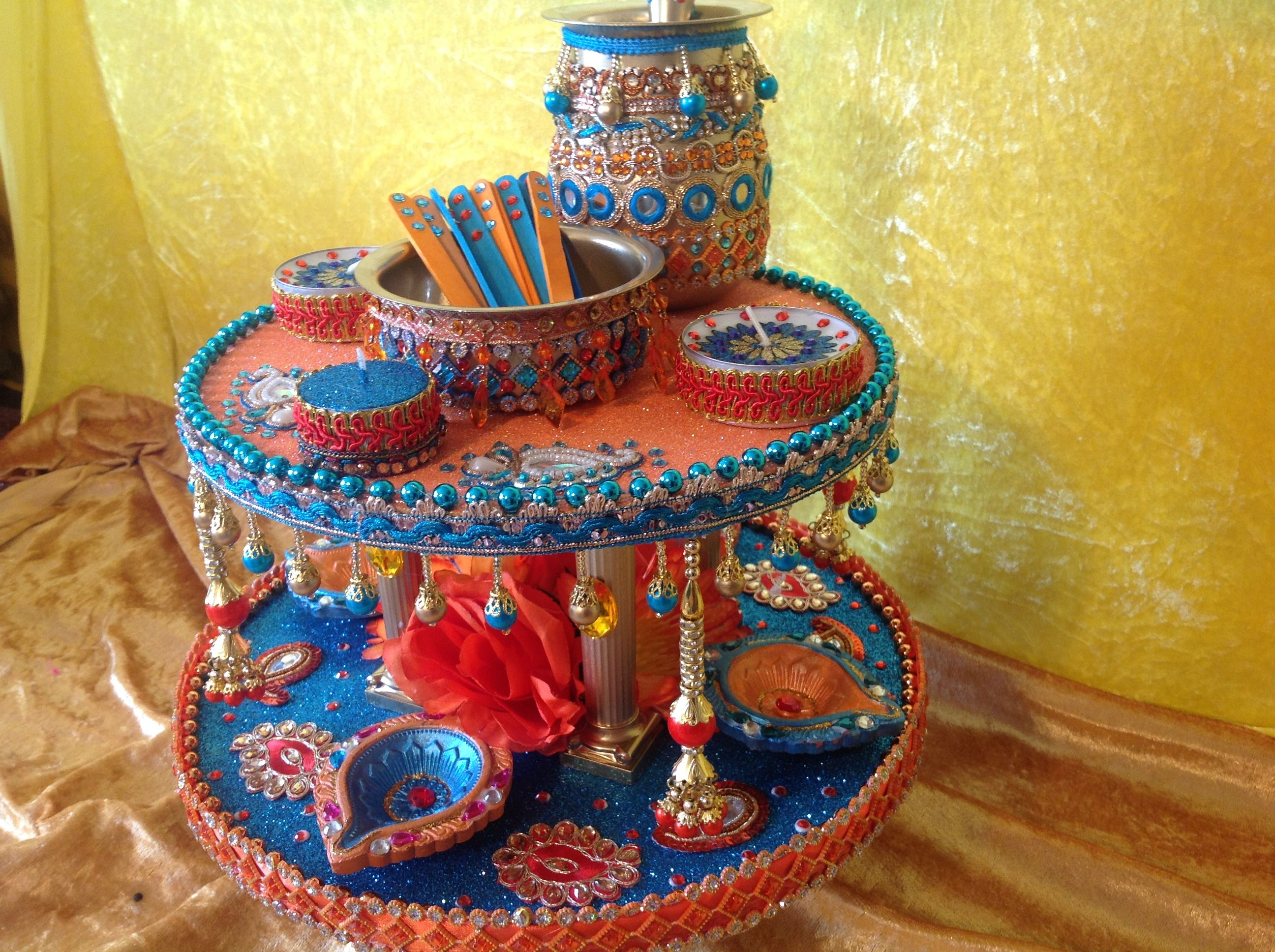 A stunning double tiered mehndi pate, for the oil and mehndi Rasam