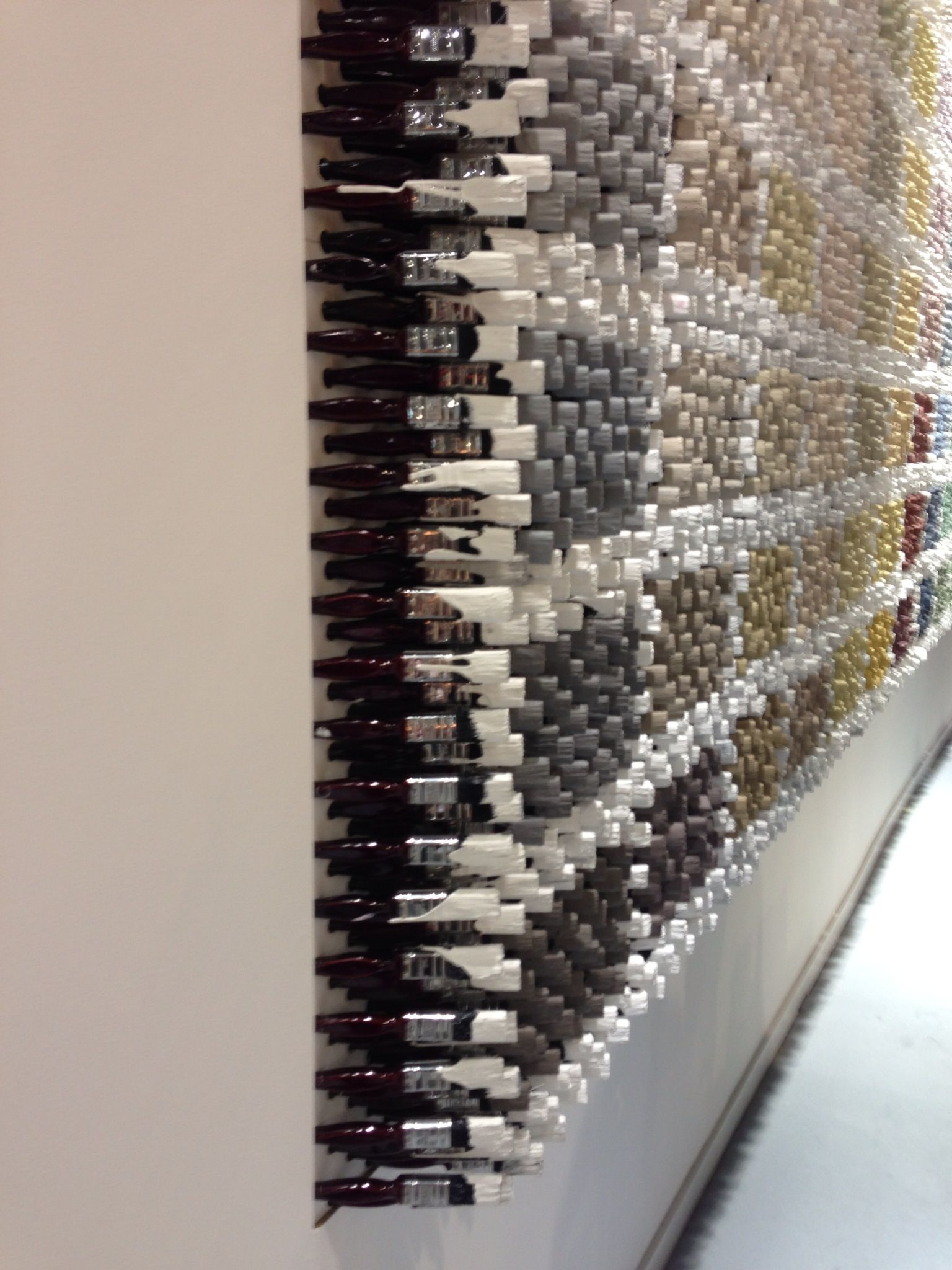 Paint brush display by Little Green Paint pany to show their