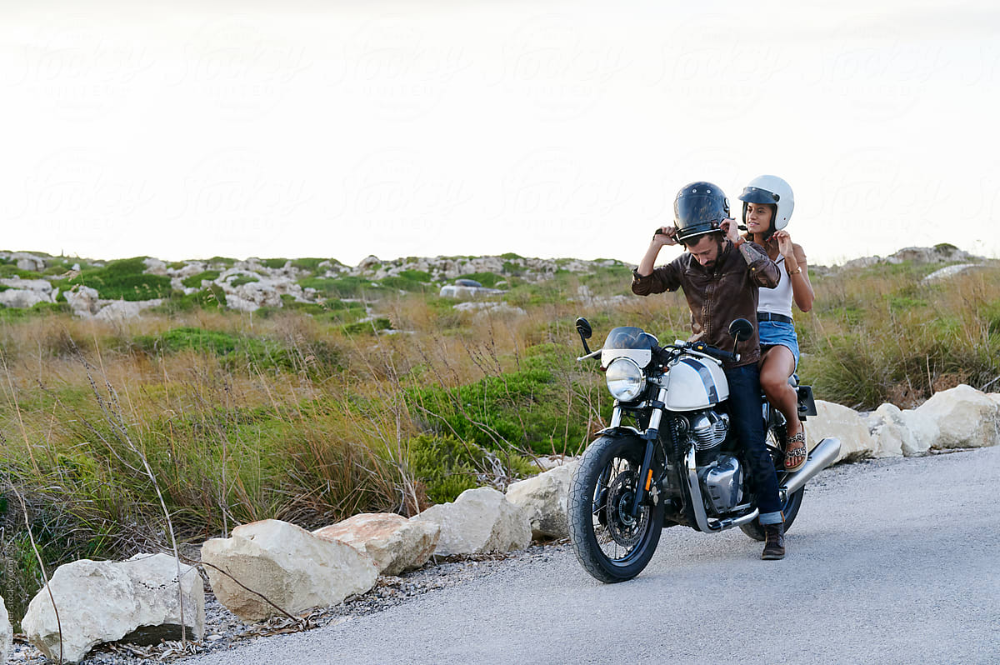 Couple Taking A Break From A Motorbike Ride By Ivan Gener Adventure Couple Riding Motorcycle Riding Couples