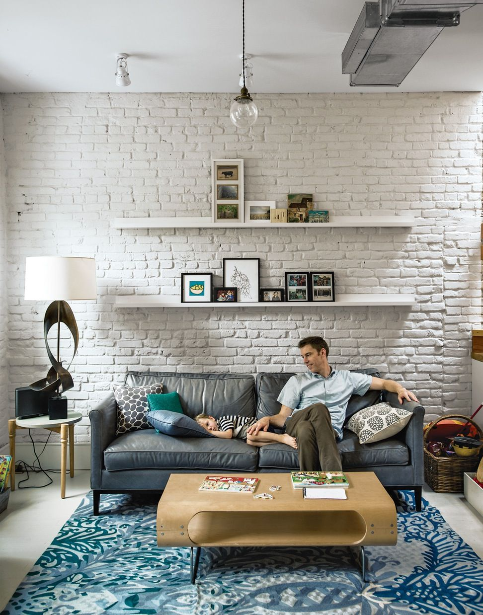 30 White Brick Wall Living Rooms That Inspire Your Design Creativity Whitewashed Bricks Painted Brick Living Room Brick Wall Living Room Brick Interior Wall