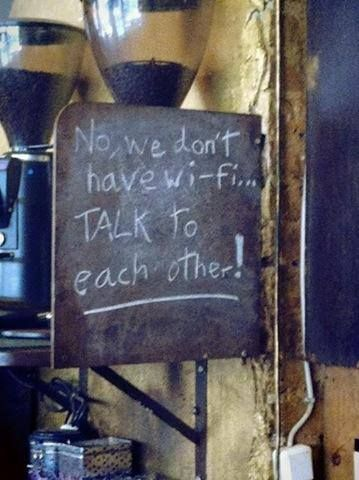 Wherever this cafe is, I want to be.  I am so sick of people and their dependency on technology to get through a day.  We have become a society of anti-social morlocks, who think 'chatting' & 'texting' is communicating.