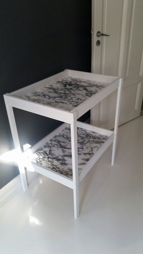 Ikea Sniglar changing table hack. Painted white and covered with ...