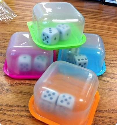 put dice in small container to shake them instead of having children toss them & the dice go flying everywhere!