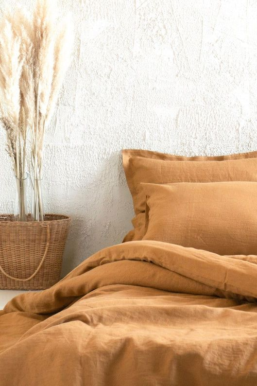 This linen sheet set in an autumnal palette will give you a whole new reason to stay in bed later on a Sunday morning.