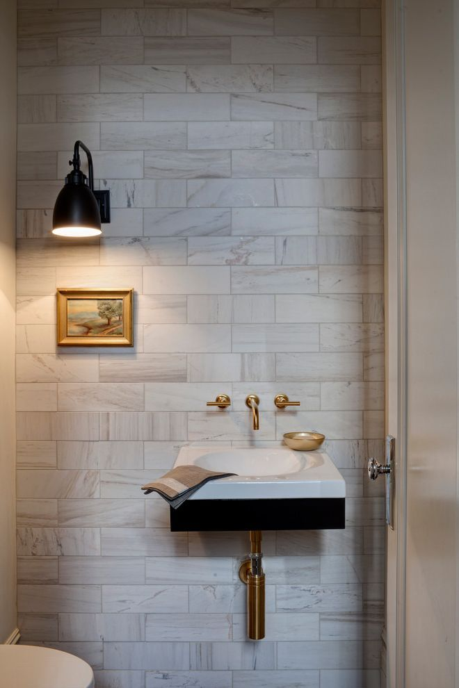 powder-room-with-small-powder-room-sinks-and-wall-sconce-in-chicago.jpg