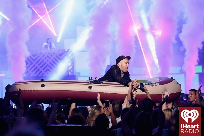 Pete Wentz rides a raft over the crowd at the 2014 iHeartRadio Music Festival during Steve Aoki's set! #iHeartRadio