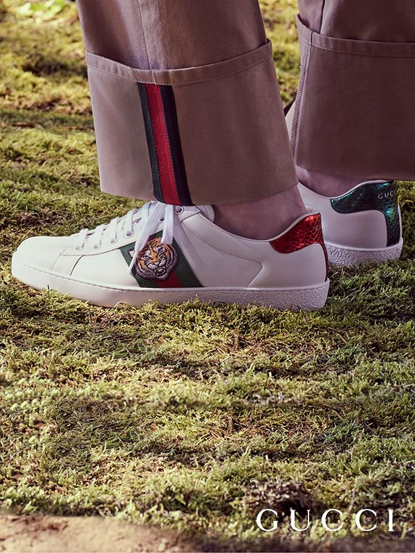 official photos 3c1e8 ce492 Discover more gifts from the Gucci Garden by Alessandro Michele. The House  Web stripes appear on trousers and the Gucci Ace sneakers, decorated with  an ...
