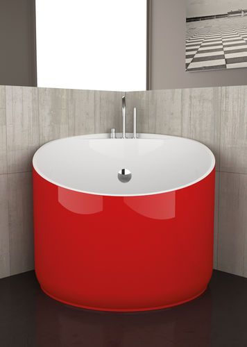Small Spaces · This Corner Configured Bathtub Is Made Even More Impressive  By Its Bright Red Hue.