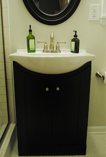 subway tiles, hex tiles and dark vanity