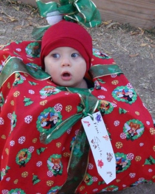 Image result for baby wrapped like a present