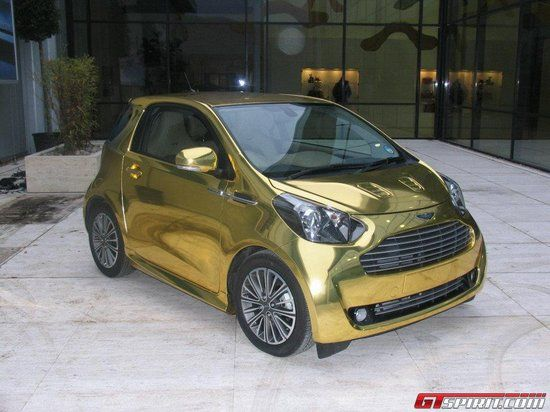 Golden Aston Martin Cygnet City Car Assures Awe Filled Stares