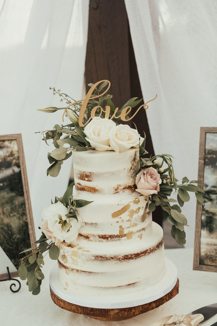 Naked Wedding Cake with gold accents and greenery