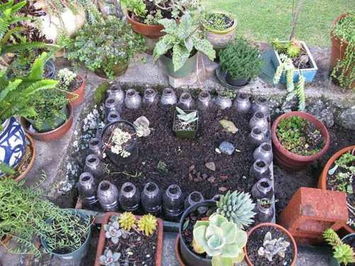 around your raised bed put plastic 2L soda bottles with holes punched in the bottom... then when it rains... water goes in the bottles and slowly waters your garden... I like this.