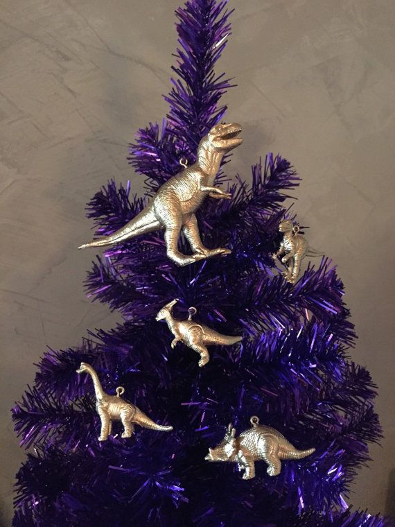 set of dinosaur christmas or holiday tree ornaments