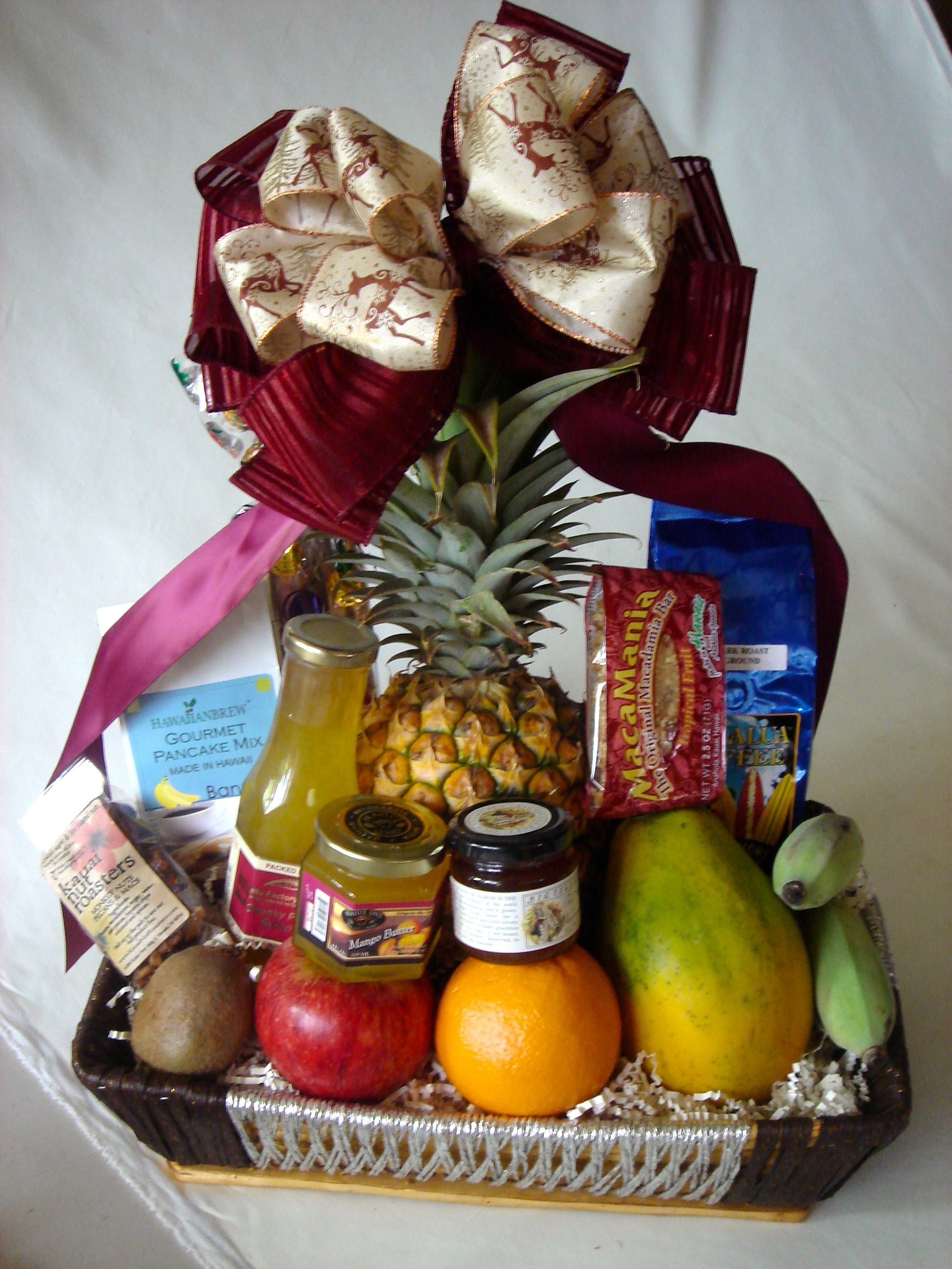 Delicious gift baskets with fresh fruit and premium Hawaiian snacks. Oahu delivery only. Price: $115.00