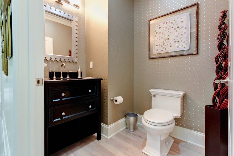 Powder room with custom furniture sink. Designed and built by Ramage Company.
