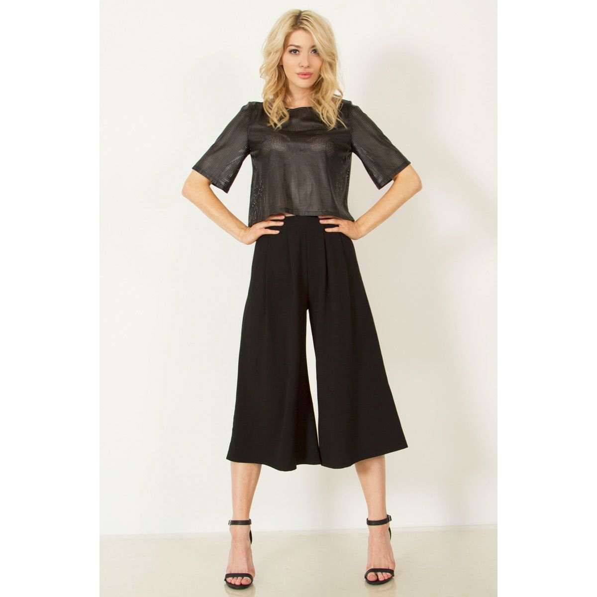 Culottes, culottes, culottes!!! MUST HAVE FOR SUMMER! Who's swinging by to borrow these pants now? Culottes are the must have item for your closet this season and these will be coveted. These wide-leg black pleated culottes can take you from daytime to evening effortlessly. Everyday Runway Boutique