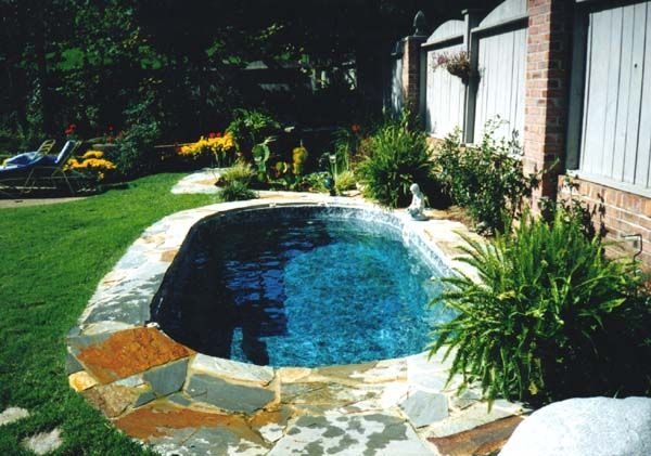 Small Oval Inground Pool Designs With Flagstone For Small Spaces