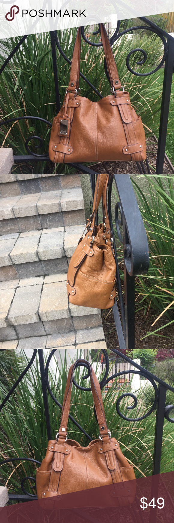 """Tignanello Large Bag.  Gorgeous. Tignanello Large Bag.  Gorgeous.  12"""" x 9 1/4"""" x 5 1/2"""". Two exterior pockets. Interior has 3 compartments with one with zipper and 3 pockets.  Body of genuine leather.  Trim PVC. Lining 100% polyester. Color best seen in pic one.  Like new.  Gorgeous. Tignanello Bags"""