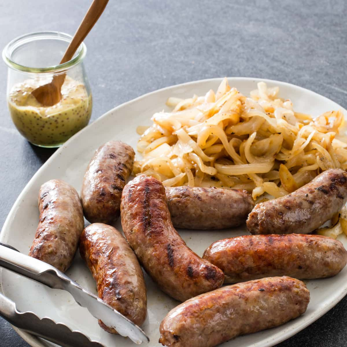 CharcoalGrilled Sausages with Onions Cook's Illustrated