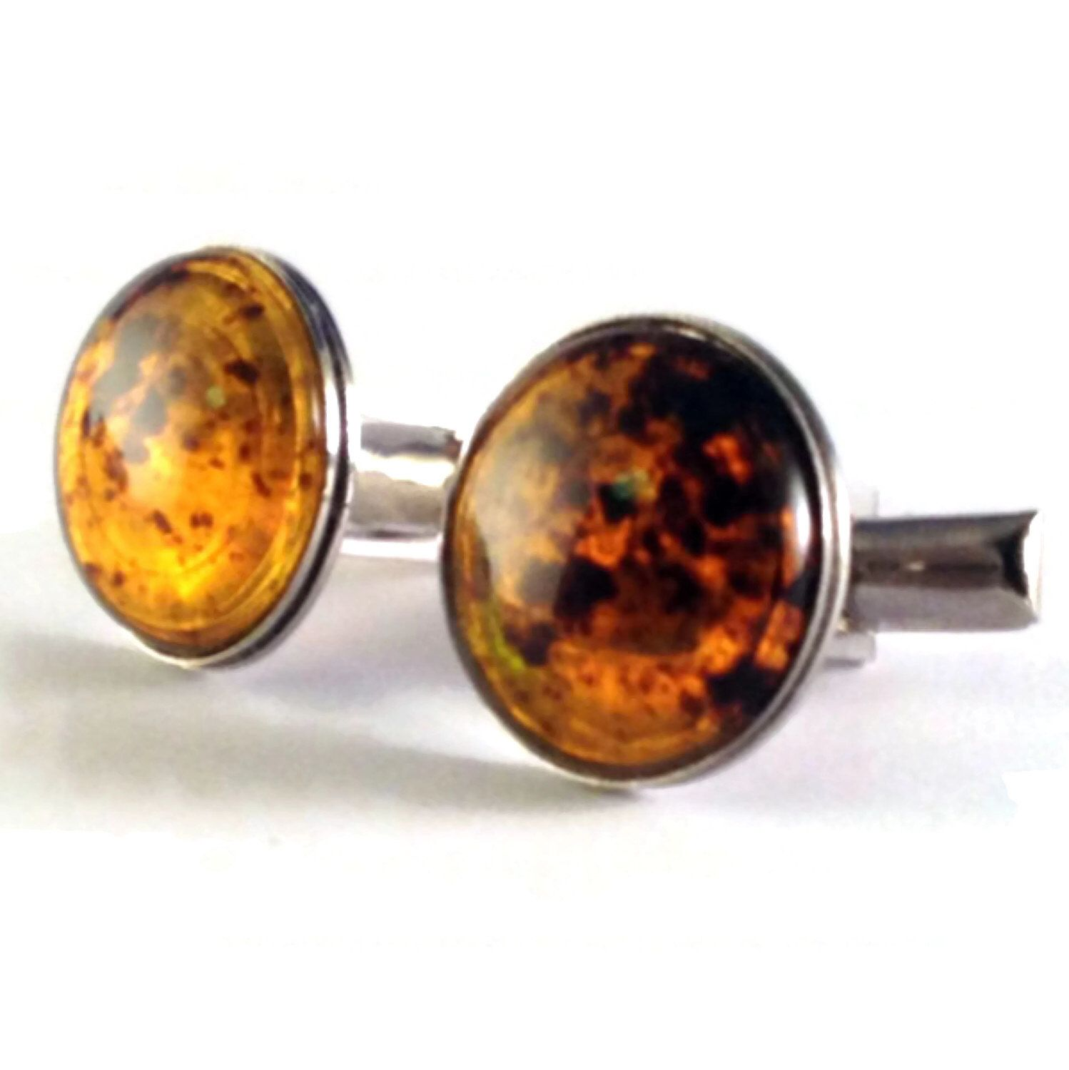 A personal favorite from my Etsy shop https://www.etsy.com/listing/152226044/sale-sale-amber-color-cabochon-cufflinks