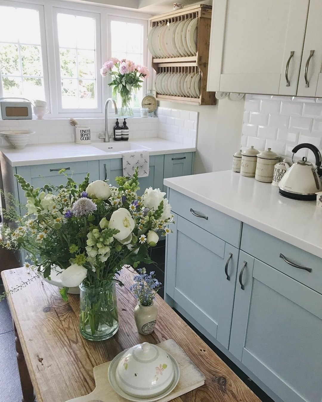 Better Homes Gardens On Instagram Fresh Flowers And Colorful Cabinets Are Always A Good Choice Cottage Style Kitchen Cottage Kitchens Kitchen Inspirations