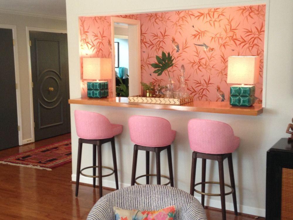 pink wallpapered kitchen  counter stools  pink bar