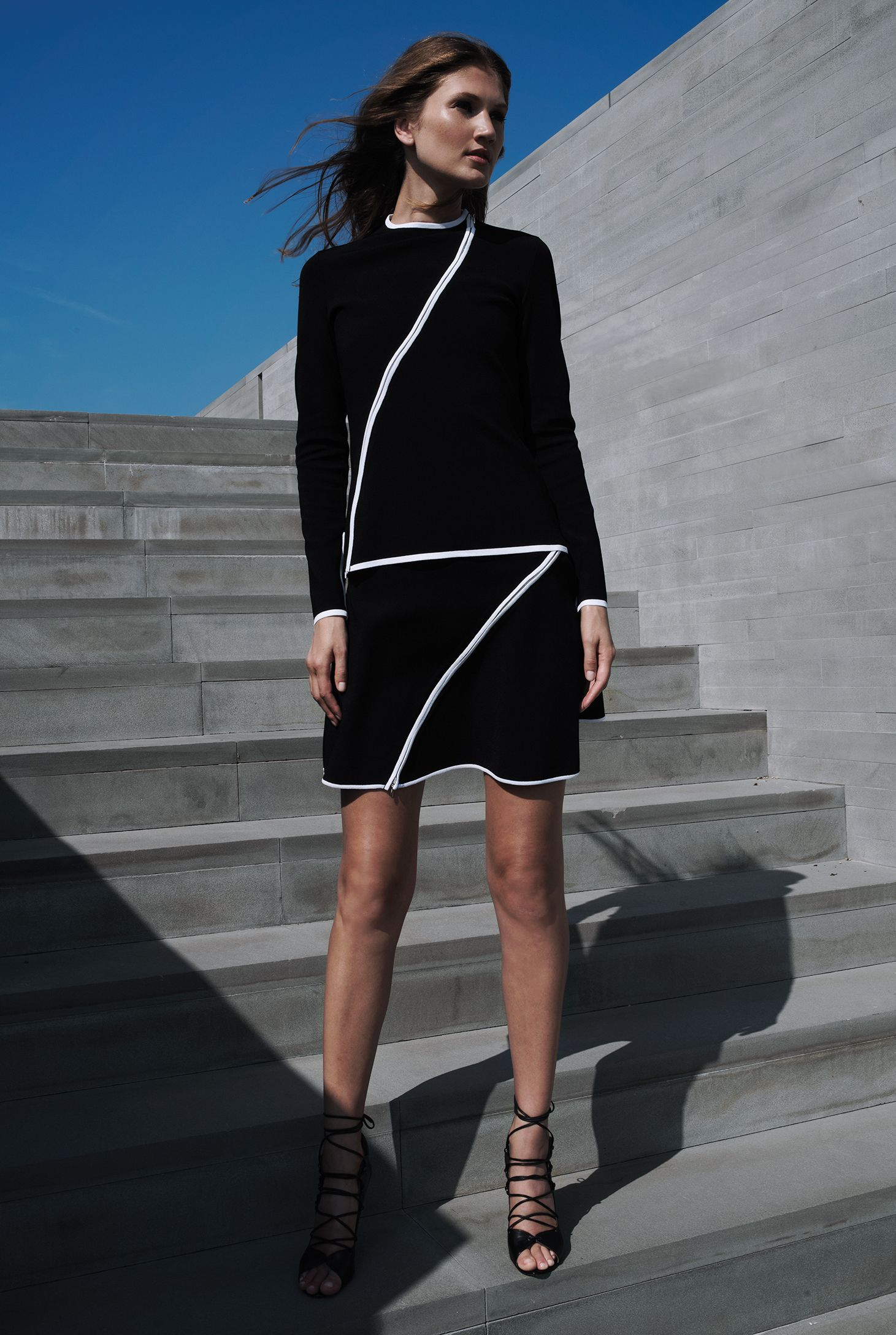 Paula's vision makes for a modernistic statement piece. Black skirt with asymmetrical diagonal zipper front to back. Yoke waist, black flared skirt. Product of France. Shown with Chantal Jacket by Paula Hian.   #classysuit #modernoutfit #professionaloutfits #workoutfits #brunchfashion #frenchstyle #womensblazer #powersuits #womenssuits #weartowork #suitsforwork #workstyle #officechic #officefashion #officestyle #pencilskirts #skirtsuit #skirtoutfit #peplumjackets #womensblazers #workoutfits