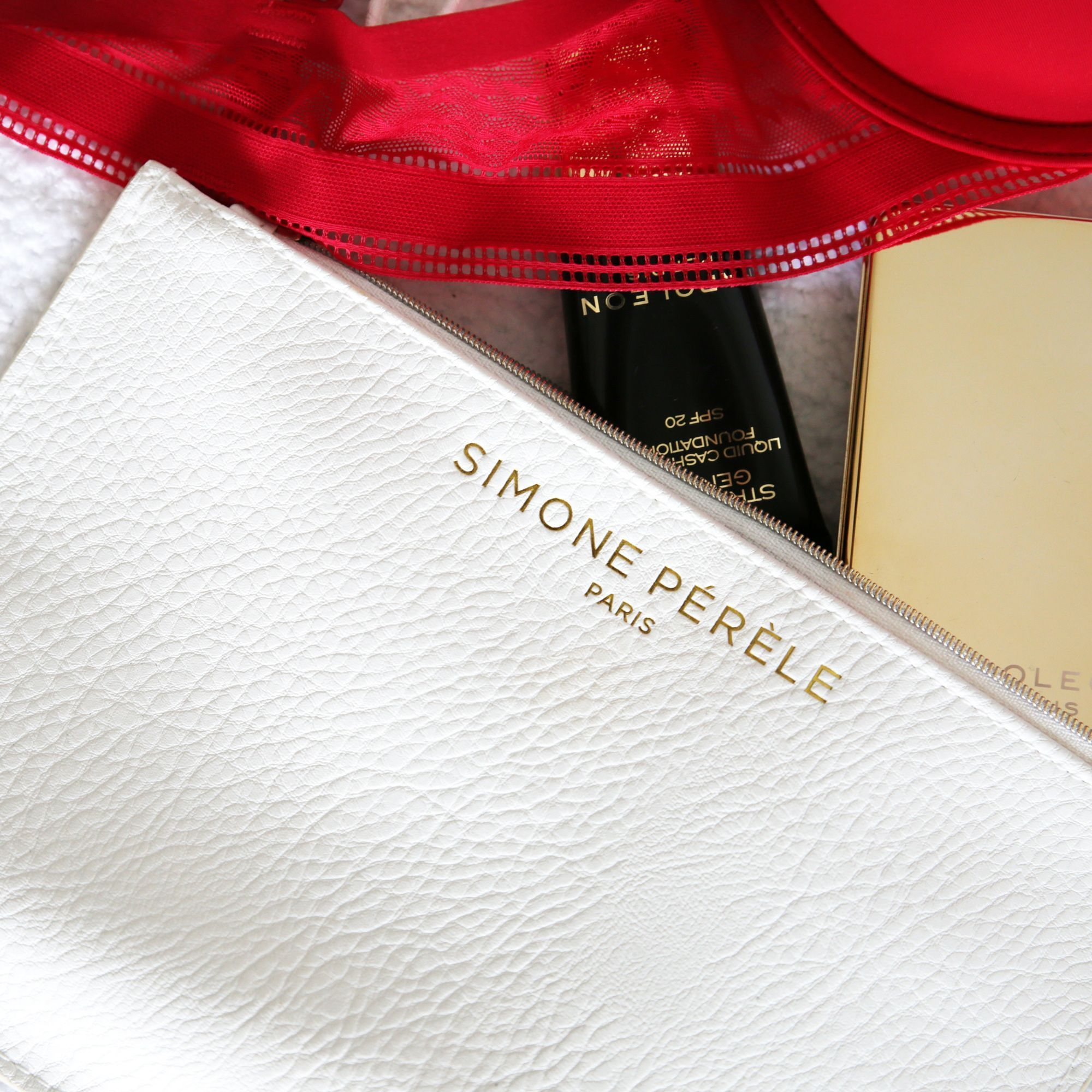 If you buy any Caresse range with your Amex card in David Jones youll get a free Simone Perele Cosmetics Clutch - Dont miss out!