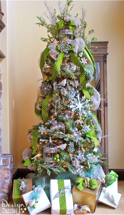 instead of wrapping your tree in a horizontal direction drape ribbon vertically for a fresh look see more at design dazzle - How To Decorate A Christmas Tree With Ribbon Horizontally