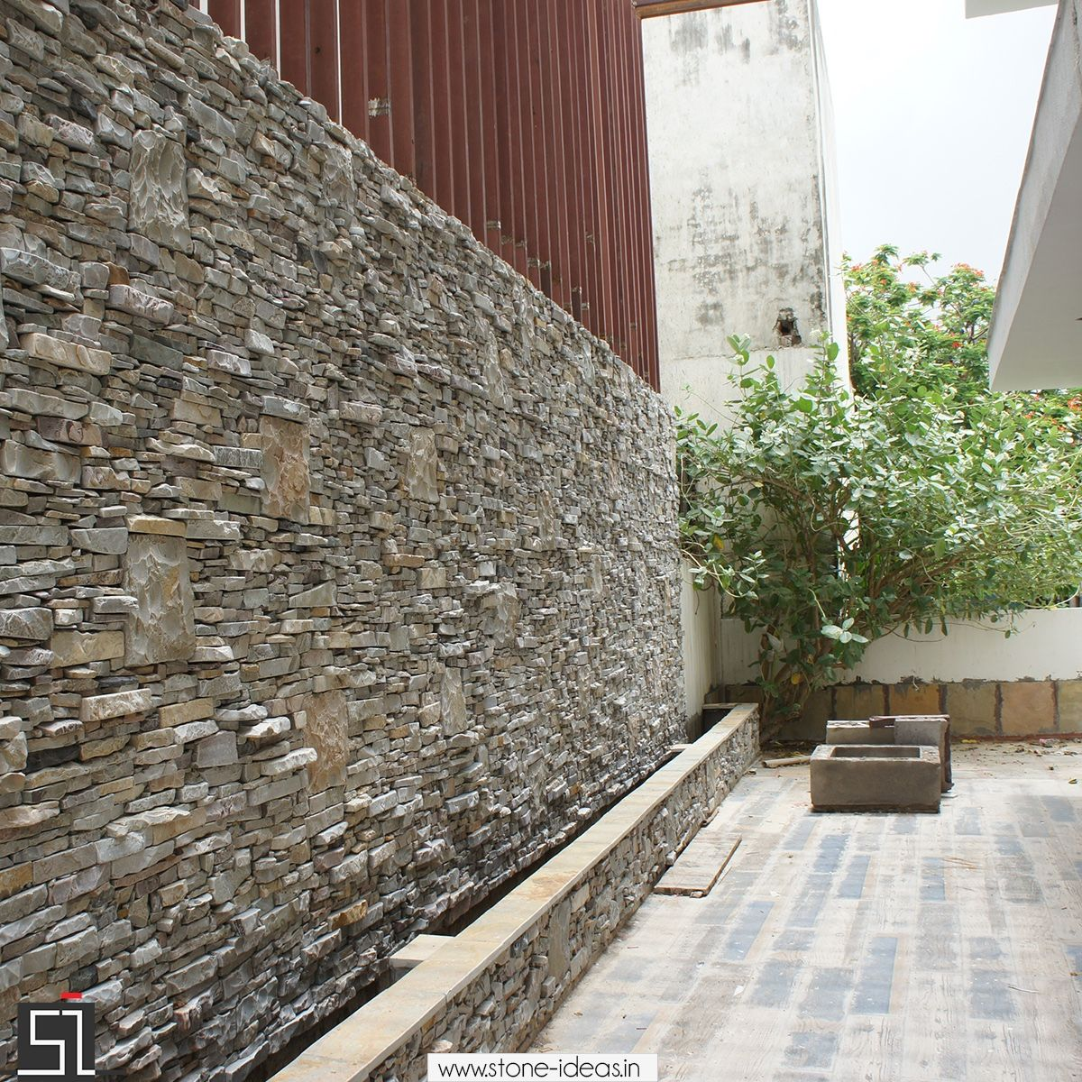 boundary wall design in stone stone