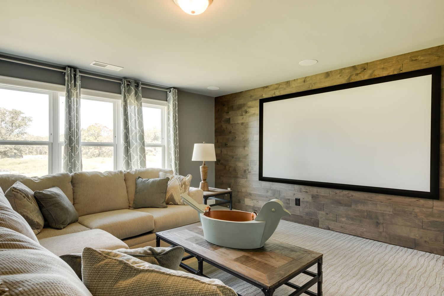 This Media Room Has A Wood Accent Wall And A Projector Screen To Create A Home Theatre This Space Is Large Yet Cozy Home Media Room Seating Home Theater Rooms