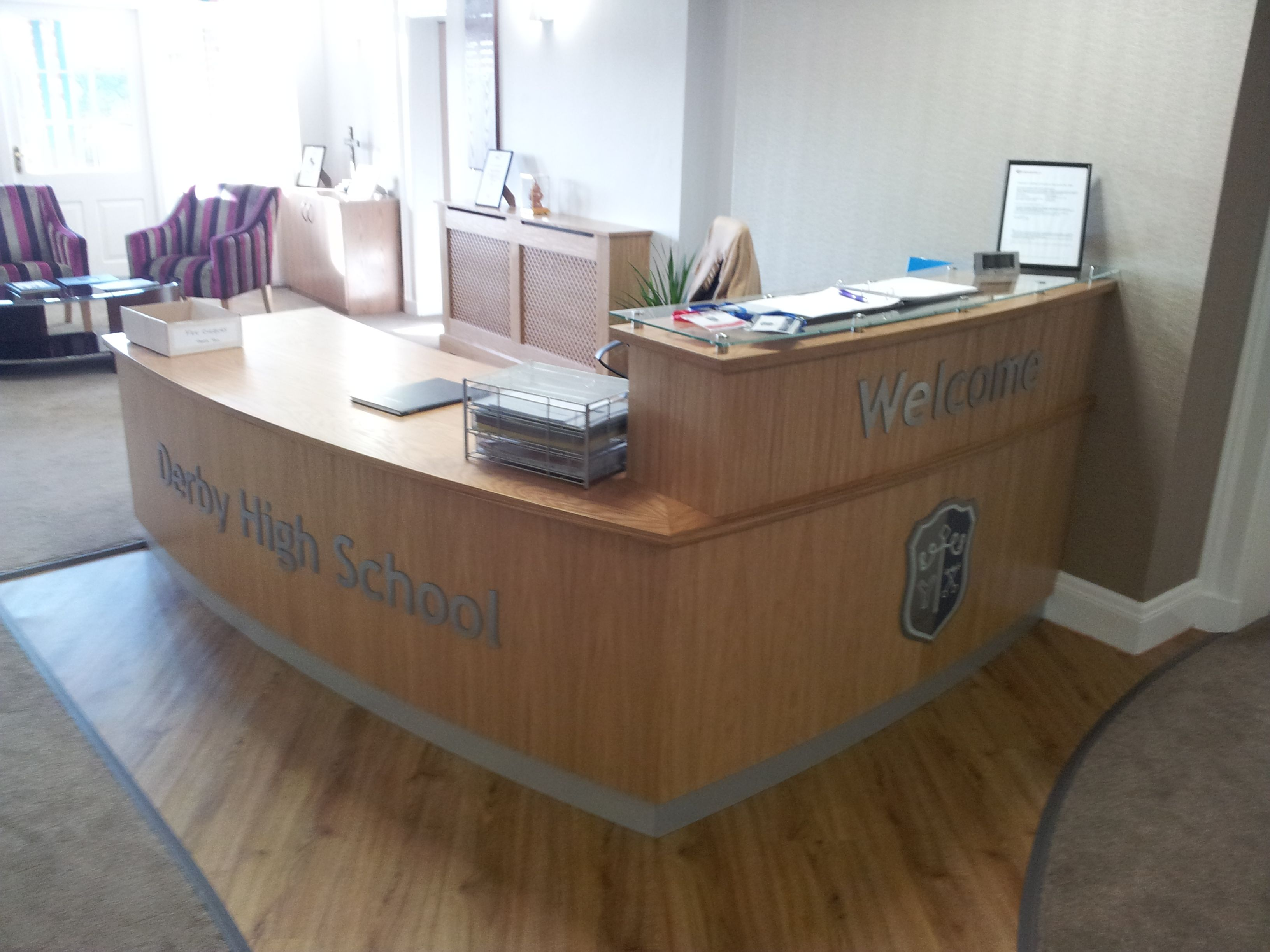 School Reception desk in oak veneer with small pedestal and a raise section with a glass top School admin Pinterest