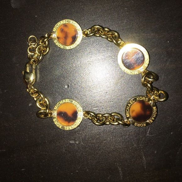 Authentic Michael Kors bracelet Worn once no box, etc. will ship in a Tory Burch dust bag because that's all I have :). Gold & tortoise. Make offers do not comment with offers, just make them. No trades. Thank you! Michael Kors Jewelry Bracelets