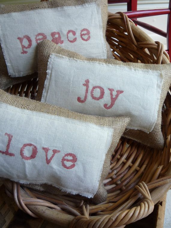 Burlap pillows -- going to give these a try, but will use embroidery on linen  instead of stamp/fabric paint.
