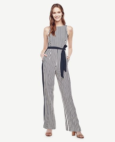 "Designed with flattering contrast side panels, our belted jumpsuit lines up your look - in one easy piece. Jewel neck. Removable tie belt. Onseam pockets. V-back. Hidden back zipper with hook-and-eye closure. Lined bodice. 31"" inseam."