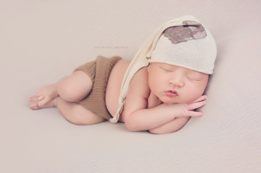 We adore little boys! We have quite a collection of hats, wraps, diaper covers, rompers and every basket, bucket and bed you can think of! We usually suggest toddler boys and Dads wear solid simple clothing in lighter colors to compliment our collections.