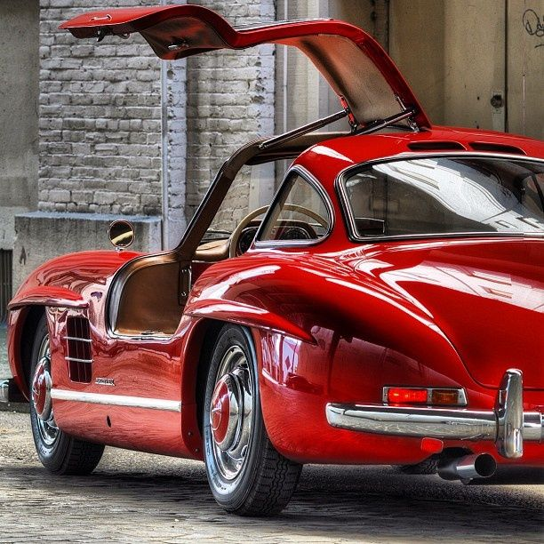300SL From Mercedes Benz Posing With Its Classic Gullwing Doors Open