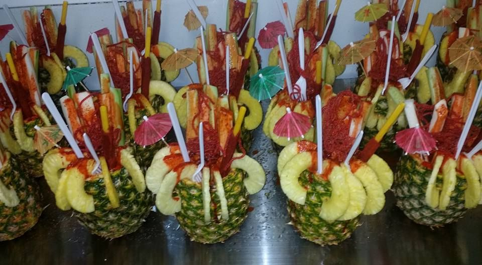Piñas Locas y riquisimas. Freshly cut pineapples filled with jicama, cucumber, peanuts, tamarind, sweet and sour sauce and hot sauce, Yum!