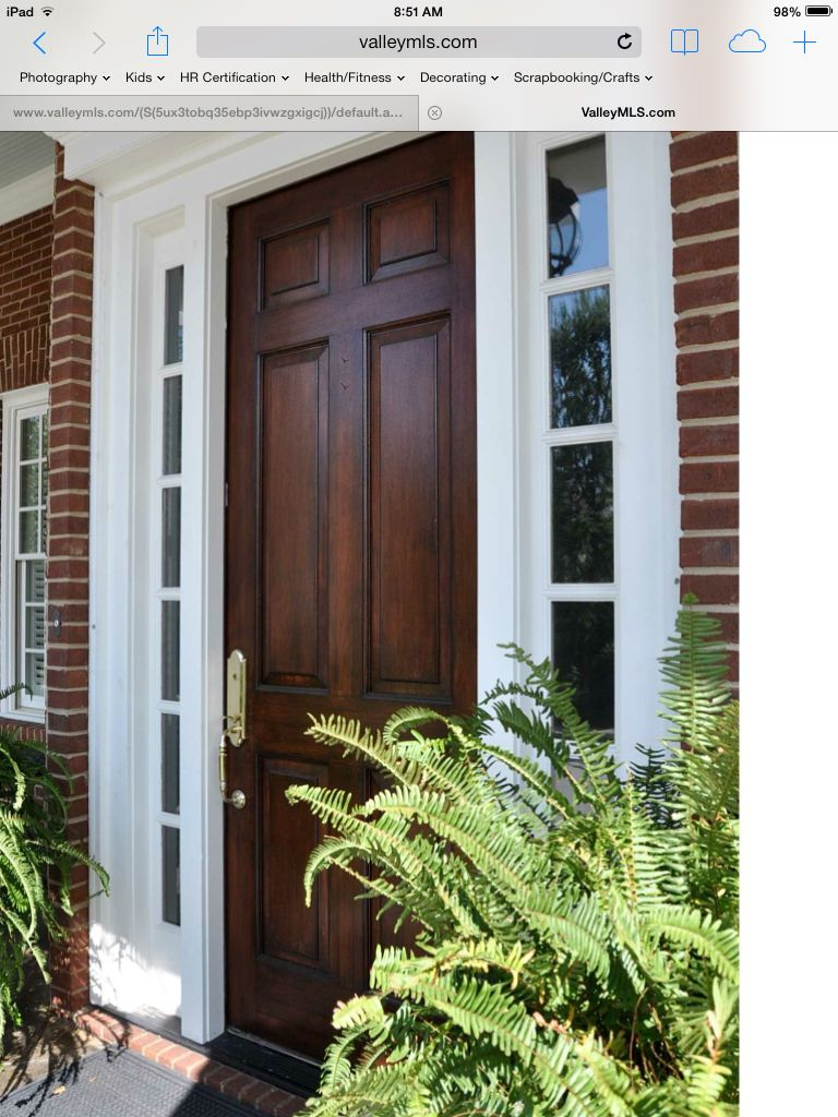 Stained Front Door With Red Brick Brick Exterior House Brick House Front Door Colors Traditional Front Doors