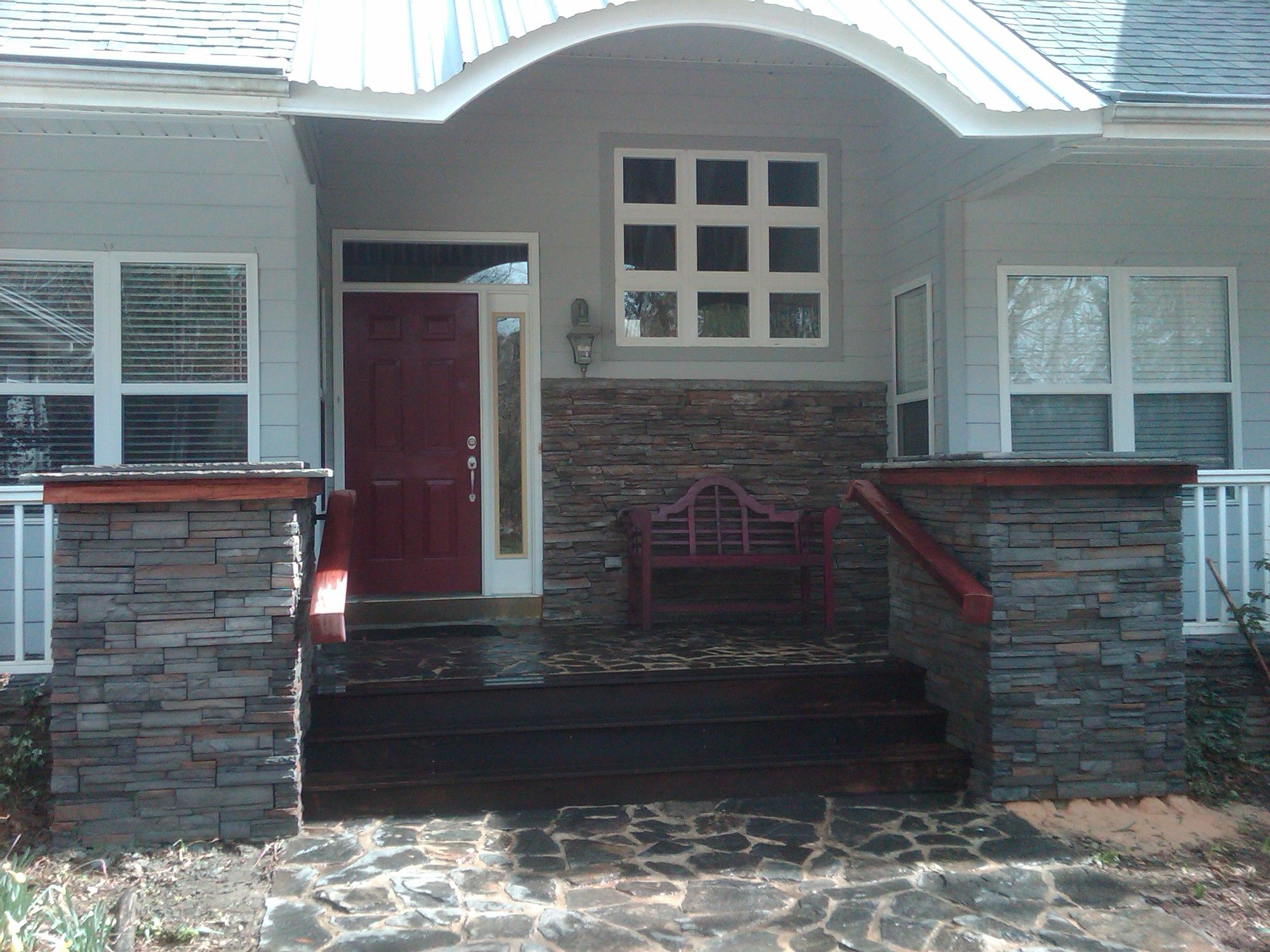 Best Front Entrance With Curved Roof And Stack Pillars Garage 400 x 300