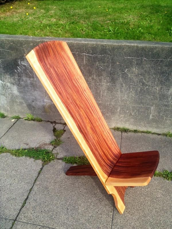 Hand carved traditional African watchmans chair, in Sapele