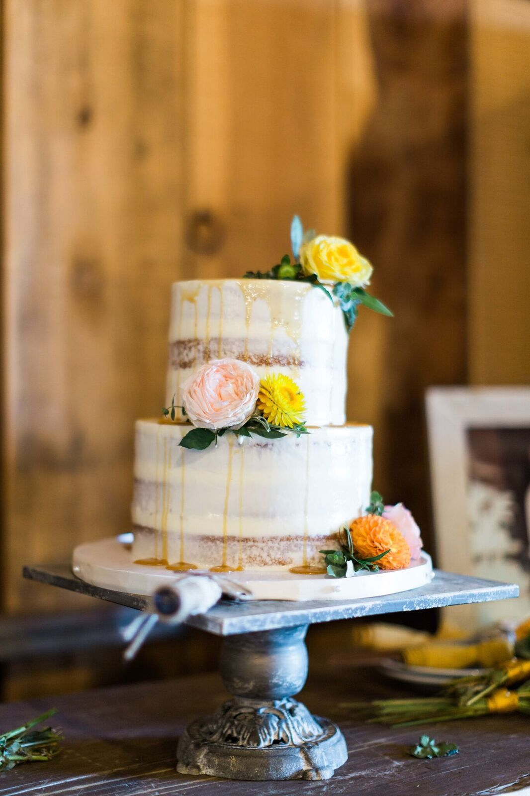 Seminaked two tier wedding cake with fresh flowers wedding design