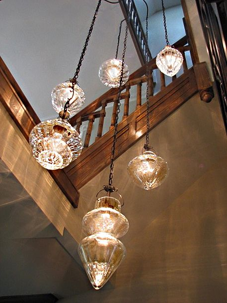Close cristallo chandelier custom fve arm chandelier with six assorted cristallo diffusers hangs in a stairwell