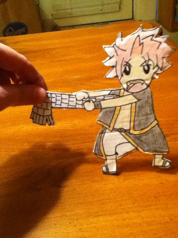 I made this little Natsu out of paper and cardboard!! He doesn't like it when you mess with his scarf! XD