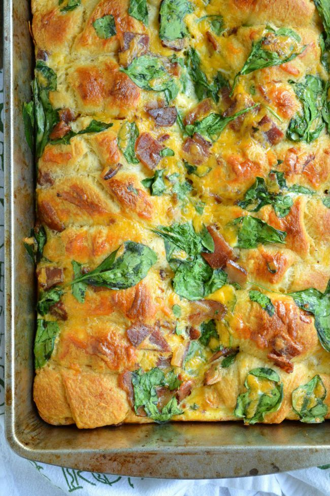 Crescent Roll Breakfast Bake Recipe -  this easy breakfast casserole is loaded with bacon, spinach, eggs, and buttery flaky crescent rolls!