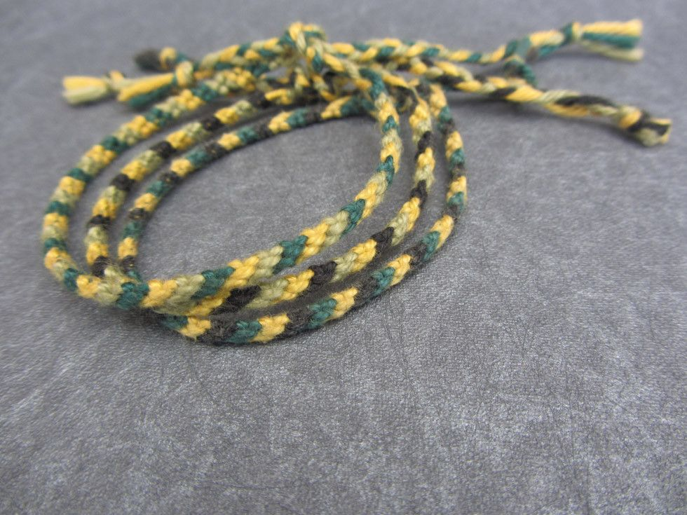 friendship bracelets - black, green, yellow