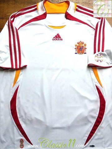 11368705b1c Relive Spain's 2006/2007 international season with this vintage Adidas away football  shirt.
