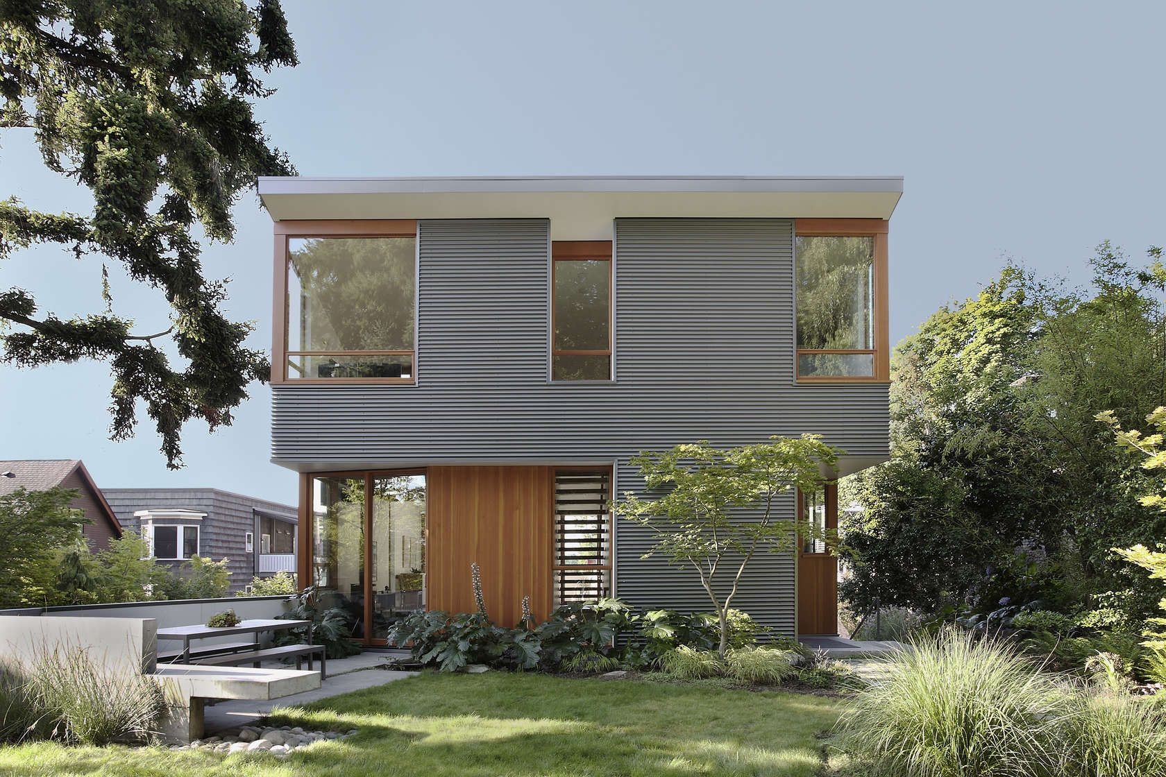 Located in Seattle's Leschi neighborhood the Main Street House takes on grid house design, wood house design, plywood house design, steel house design, paper house design,