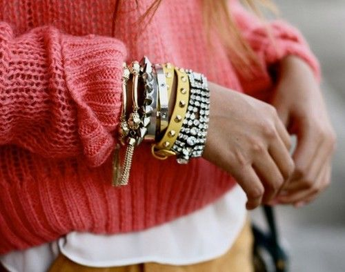 Chunky sweater and stacks of bracelets